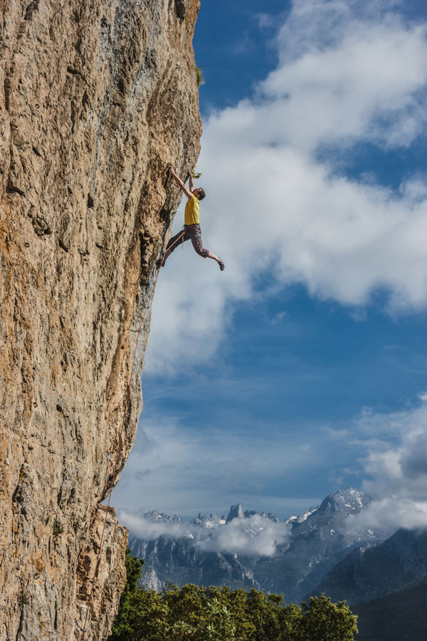 Flying high on the amzing 6c+ which graces the cover of the guide with the Picos in the background...